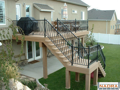 Second story trex saddle with ornamental iron railings for 2nd story deck plans