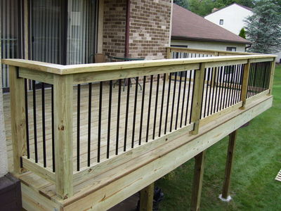 Pressure Treated Lumber Deck w/Aluminum Balusters By: MJ Cannon Home  Enhancements, Inc. 215-343-0606