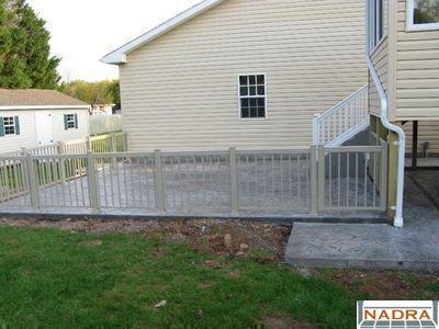 Aluminum sunspace aluminum railing nadra gallery of for Concrete patio railing